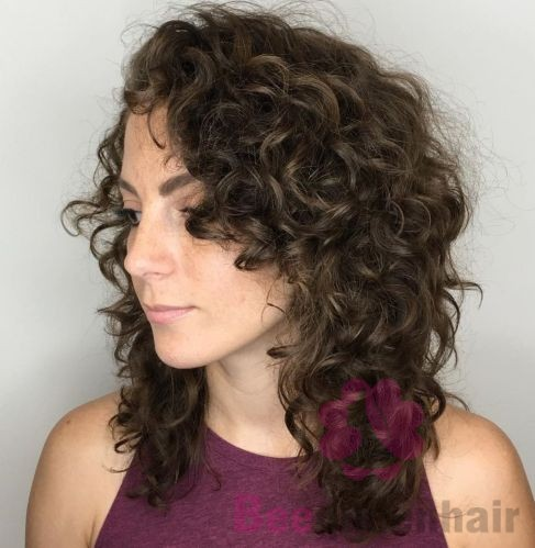 Medium Length Curly Layered Hairstyle