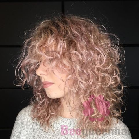 Mid-Length Light Pastel Pink Curly Hairstyle