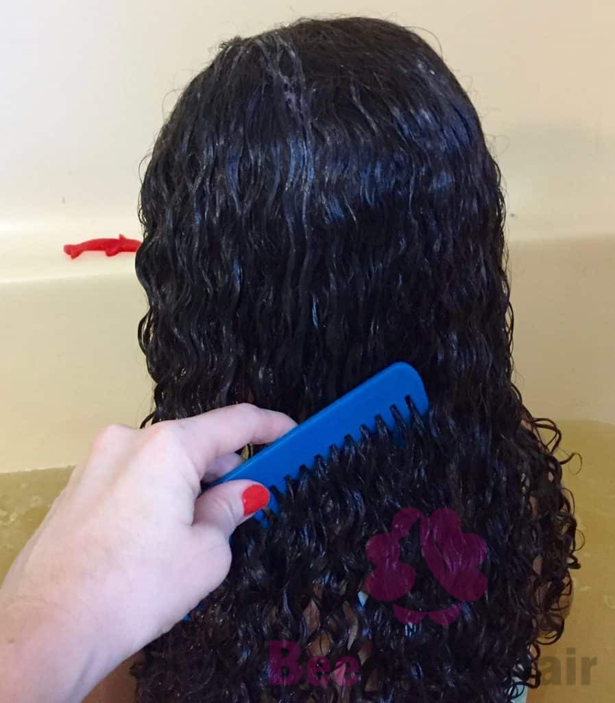 use a wide-toothed comb to detangle the hair