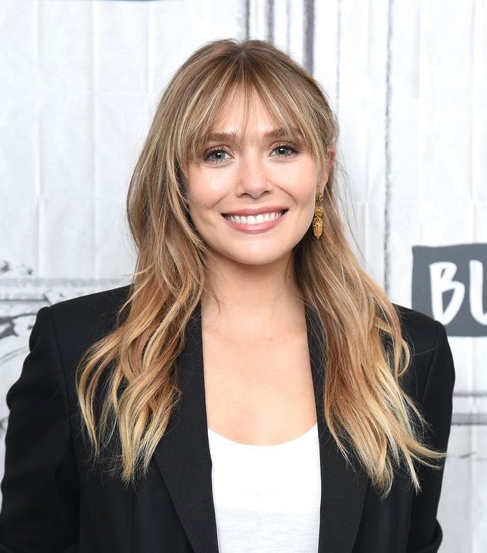 Wear Layered Bangs For A Wider Face Shape